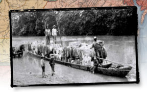 A bateau on the Haw River loaded with cotton bales