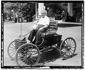 Elderly Gilbert Waters sits in his Buggymobile