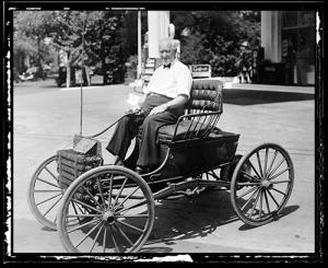 Elderly Gilbert Waters sits in his Buggymobile