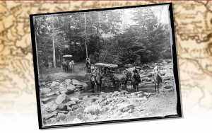 Wagons crossing a rocky river bed