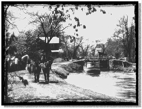 A canal boat towed by mules along the Erie Canal