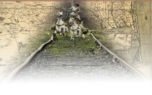 A whimsical picture of a Roman chariot charging down an old set of railroad tracks