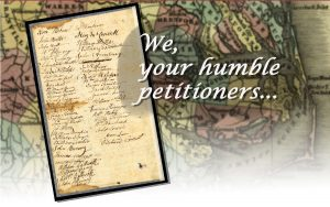 "The words ""We your humble petitioners"" with a signature page from a 1700s North arolina road petition"