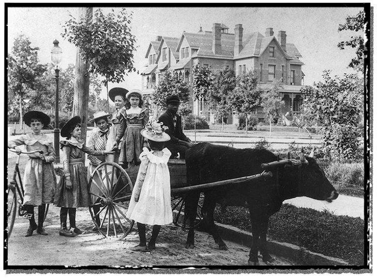 A gaggle of Raleigh girls with their oxcart.