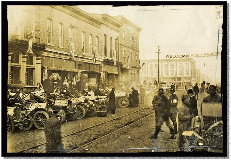 The cars of the Good Roads Tour lined up on the street in Winston Salem, 1909