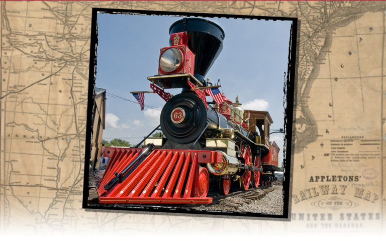 A bright red cowcatcher on a steam engine