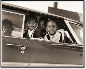 Black children enjoying a car ride
