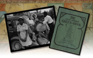 A copy of the Negro Motorist Green Book and a picture of a family of black motorists