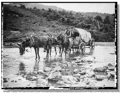 A wagon fords a river